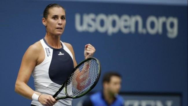 Flavia Pennetta, of Italy, reacts after winning the first set against Roberta Vinci, of Italy, during the women's championship match of the U.S. Open tennis tournament, Saturday, Sept. 12, 2015, in New York. (AP Photo/David Goldman)