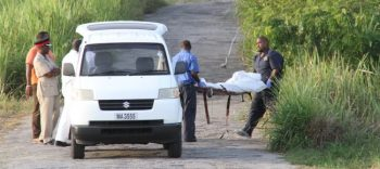 Melanese Eversley being taken away after her body was discovered at Jordan, St George yesterday.