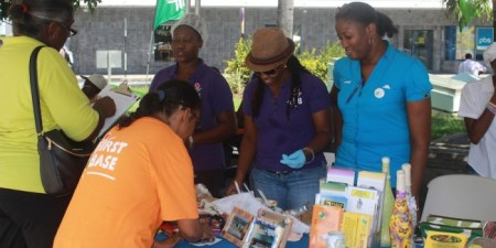 Volunteers from the Barbados Council for Disabled showing off their products.