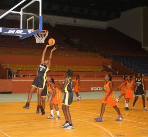 Latifa Wood (going up to the basket) played inspirational basketball for Hoopsters.