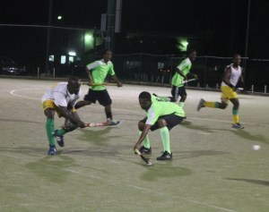 Ricardo Jones of Barbados Defence Force did well to get one past Barbados Union of Teachers' goal scorer Shawn Foster.