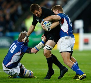 Richie McCaw of the New Zealand All Blacks is tackled by Renaldo Bothma (left) and Johan Deysel of Namibia during their match today.