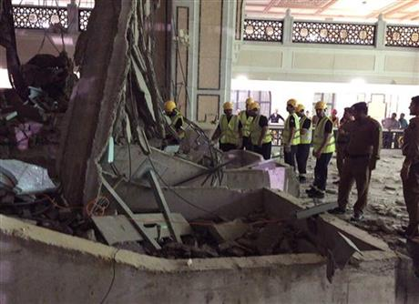 In this image released by the Saudi Interior Ministry's General Directorate of Civil Defense, Civil Defence personnel inspecti the damage at the Grand Mosque  in Mecca after a crane collapsed killing dozens today.
