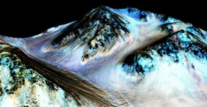 This undated photo provided by NASA and taken by an instrument aboard the agency's Mars Reconnaissance Orbiter shows dark, narrow, 100 metre-long streaks on the surface of Mars that scientists believe were caused by flowing streams of salty water.