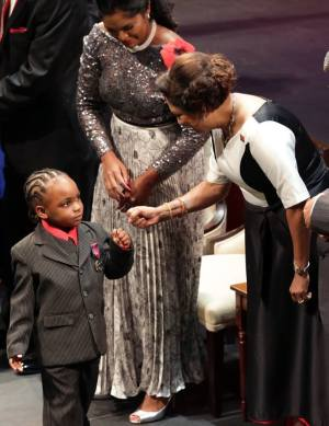 "Tiny hero Kal-el Alleyne (left) receiving a ""bounce"" from Prime Minister Kamla Persad-Bissessar."