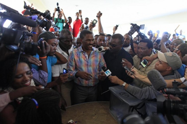 Presidential candidate Jude Celestin, from the LAPEH party, speaks to the press after casting his ballot at a polling station during elections in the Petion-Ville suburb of Port-au-Prince, Haiti, Sunday, Oct. 25, 2015. The country is holding the first-round presidential vote Sunday along with balloting for numerous legislative races and local offices. (AP Photo/Ricardo Arduengo)