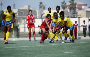 Barbados and Peru fight for possession of the ball in today's key game.