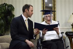 Catholic Central High School Principal Greg Deja, left, presenting 97-year-old Margaret Thome Bekema with her honorary diploma at Stonebridge Manor yesterday.