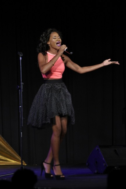 Beviny Payne delivering Can't Take My Eyes Off You,  which won her Best Talent.
