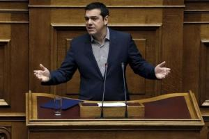 Greece's Prime Minister Alexis Tsipras answering a question on migration, during the Prime Minister's Question Time at the parliament in Athens, Greece, yesterday.