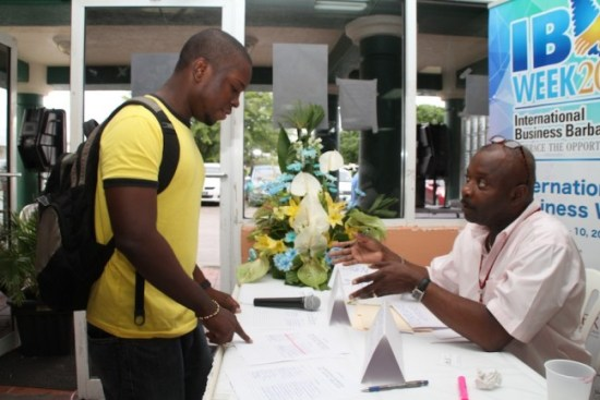 Dwight Browne (Left) speaking with Norman Mason today at today's career showcase by the Barbados International Business Association (BIBA) at the University of the West Indies Cave Hill Campus. international business sector following