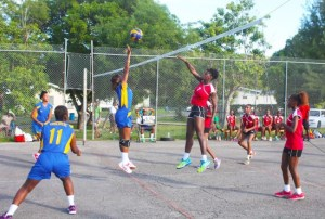 Kayla James of Queen's College slams one past Combermere's defence.