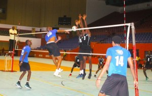 Chargers spiker Mark Lewis had a good night with some powerful shots like this one that he put past Barbados Juniors defenders Akeem Mayers (left) and Carlos Cyrus. (Pictures by Morissa Lindsay)