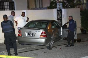 Police officers at the scene of the shooting of PC Montgomery Guy on Agra Street, St James, on Sunday night.