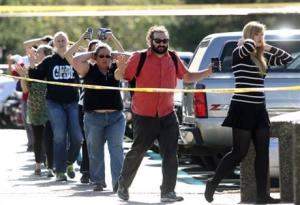 Students, staff and faculty being evacuated from Umpqua Community College in Roseburg, Oregon after a deadly shooting today.
