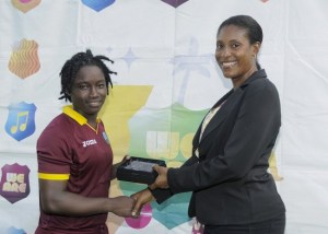 Deandra Dottin receives the Player-of-the-Match award from assistant secretary of the Grenada Cricket Association Michelle Bideau.