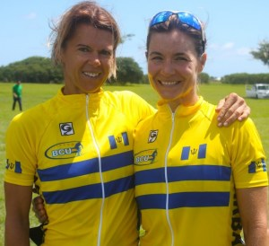 From left, Dominique Marshall who placed fourth for Barbados in the women's road race and teammate Marrissa Bradshaw who was ninth are all smiles after the race.