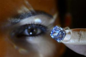 A Sotheby's employee displaying the rare Blue Moon Diamond during a preview at Sotheby's, in Geneva, Switzerland.