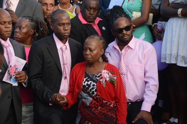 Her mother Angela Phillips is supported by family members.