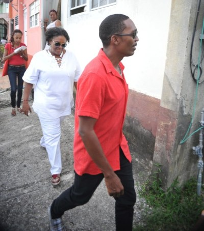 Newly endorsed candidate Adrian Forde leading Opposition Leader Mia Mottley during yesterday's mass canvass in the Christ Church West Central constituency.