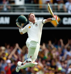 David Warner celebrates on reaching his century.