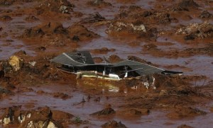 Debris of a house at Bento Rodrigues district, covered with mud after a dam owned by Vale SA and BHP Billiton Ltd burst in Mariana, Brazil, today.
