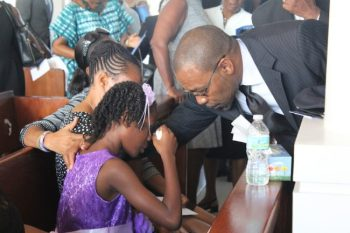 Judge Winston Anderson of the Caribbean Court of Justice offering comforting words to Carter's youngest daugther AAliyah.