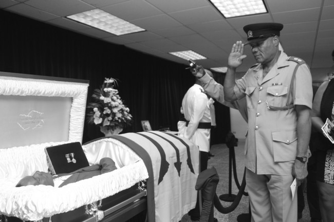 From one officer to another. Thompson receives a final salute.