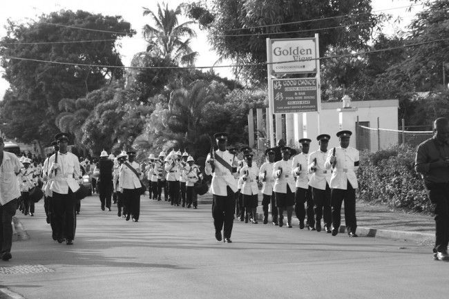 Members of the Royal Barbados Police Force march smartly en route to the final resting place of one of their own, the late Acting Assistant Commissioner of Police, Mark Thompson.