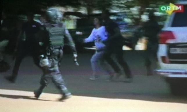 Still image from video show a hostage rushed out from the Radisson hotel in Bamako, Mali, November 20, 2015.  REUTERS/REUTERS TV