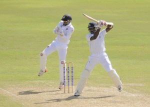 Shamarh Brooks on the attack during his unbeaten 102 today.