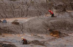 Rescue workers searching for victims at the Bento Rodrigues district that was covered with mud after a dam, owned by Vale SA and BHP Billiton Ltd, burst in Mariana, Brazil, on Sunday.