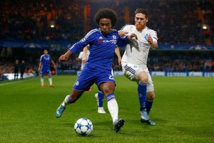 Willian (left) of Chelsea is challenged by Vitorino Antunes of Dynamo Kiev. The Brazilian would later score the winner.