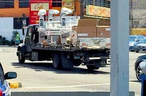 This photo, released by Daryl Vaz yesterday, shows what appear to be incubators being transported on a flatbed at the Matlida's Corner intersection in Liguanea recently.