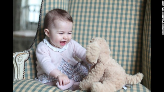 Princess Charlotte plays with a stuffed dog in this photo taken by her mother in early November.