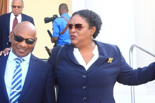 BLP chairman Mia Mottley and party attorney Roger Forde,QC, at court.