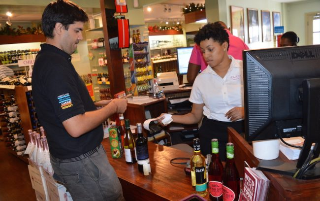 Store Manager at Wine World Warrens Denise Thorne (right) and customer Michael Brown.