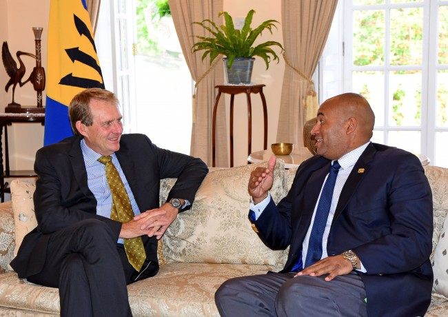 Acting Prime Minister Richard Sealy making a point during discussions with Australia's Ambassador to Barbados, Ross Tysoe.