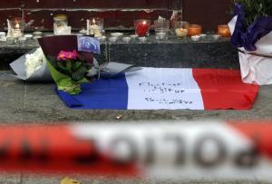 Flowers and candles placed outside the Le Carillon restaurant the morning after a series of deadly attacks in Paris on November 14.