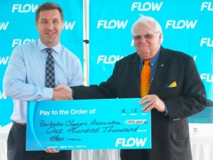 From left, FLOW Managing Director Niall Sheehy presents Barbados Olympic Association President Steve Stoute with the cheque. (Picture by  Morissa Lindsay)