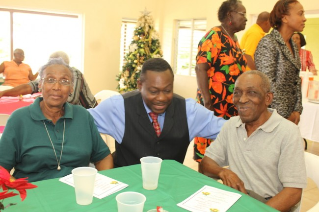 Minister of Social Care Steve Blackett enjoying the company of Etheline Jordan and her husband Joseph.