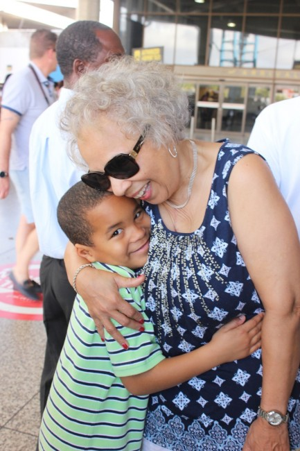 Brenham Lilavois (left) being warmly embraced by his grandmother Dorothy Tatem.