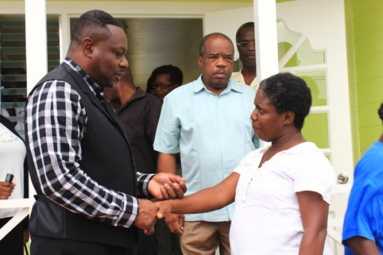 Minister of Social Care Steve Blackett (left) handing Sandra Hinds (right) her keys as consultant with the Identification, Stablisation, Enablement and Empowerment (I.S.E.E) Bridge Programme Ken Knight (centre) looks on.