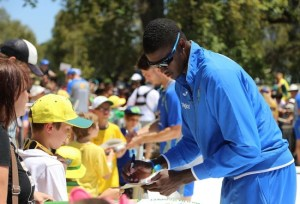 Jason Holder signs an autograph for a fan ahead of the Melbourne Test.