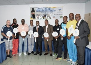Minister of Sports Stephen Lashley (fifth left) poses with some of the participants of the Road Tennis International Workshop.