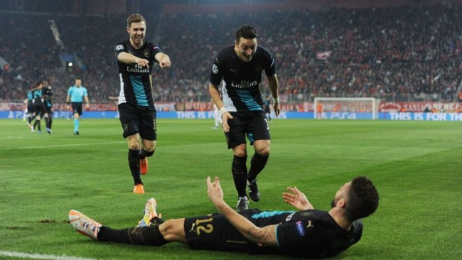 Olivier Giroud celebrates after scoring one of his three goals.
