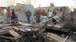People inspecting a storm-damaged home in the Roundaway community near Clarksdale, Mississippi, today.
