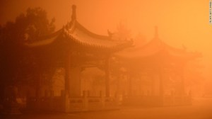 The pollution casting an apocalyptic glow over the pagodas on the streets of Hohhot, Inner Mongolia on November 29.