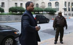 William Porter, left, one of six Baltimore city police officers charged  in connection with the death of Freddie Gray, arrives at a courthouse  as jury deliberations continue in his trial today.