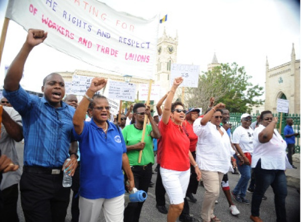 From left, NUPW President Akanni McDowall, acting General Secretary Roslyn Smith, Barbados Secondary Teachers' Union President Mary Redman, and Opposition Leader Mia Mottley leading the NUPW march.